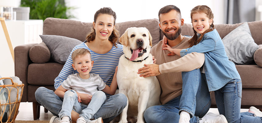 family with pet enjoying the best indoor air quality